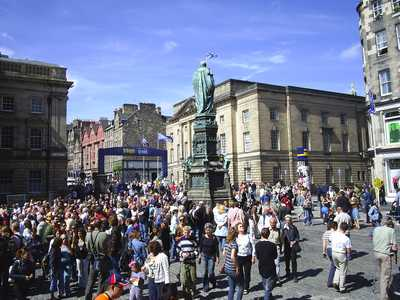 Crowds watch street entertainers on the High Street during the Festival